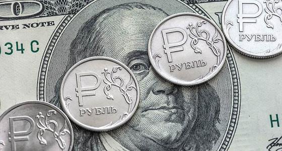 Рубль окреп вслед за нефтью