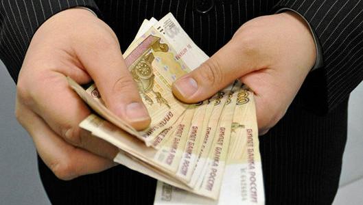 Задолженность по зарплате в РФ за декабрь снизилась почти на треть